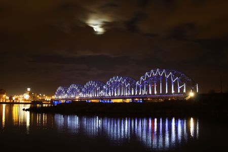 Night lighted bridge withh moon and river photo