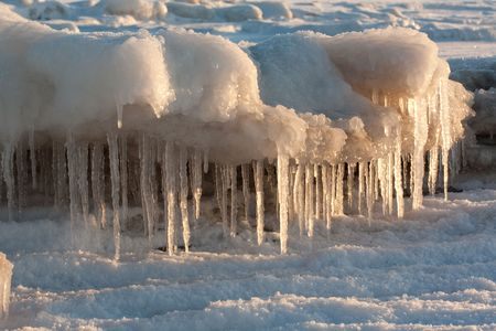 Icicles in winter on sunset light photo