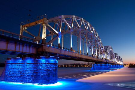 Railway bridge at night in winter photo