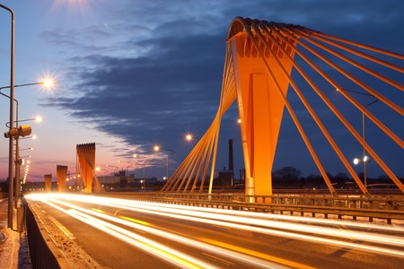 Cable bridge at evening with road Stock Photo
