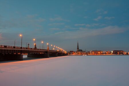 Night city bridge in winter photo