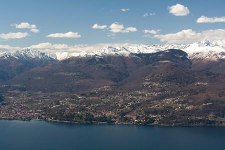 Mountains near lake with houses photo
