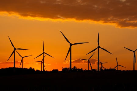 Windmill silhouette on suset background photo