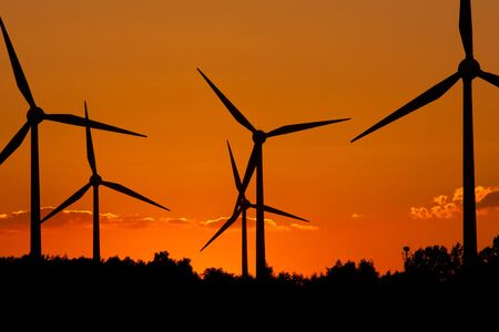Windmill silhouette on suset background Stock Photo - 8386119