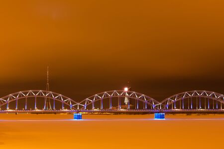 Railroad bridge in Riga in winter t night photo