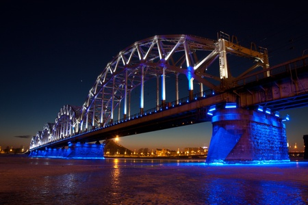 Railway bridge at night in winter close up photo