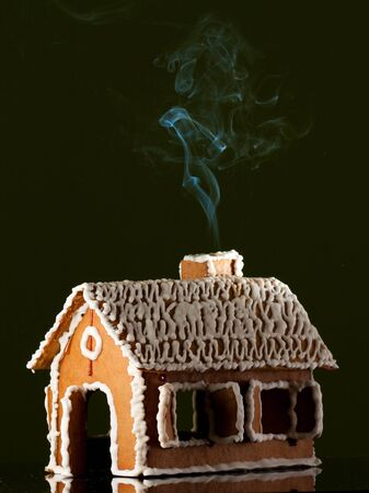 Gingerbread house on black isolated Stock Photo - 10507244