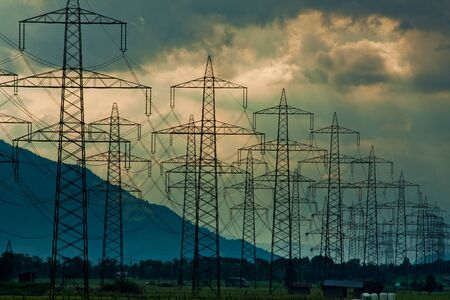 Electricity towers and cabels on cloud background in Austria Standard-Bild