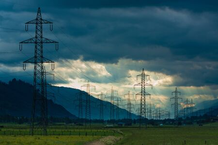 Electricity towers and cabels on cloud background in Austria Stock Photo