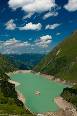 Kaprun Dam, lake and Alps in Austria photo