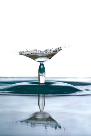 Water drop falling and colliding with another one Stock Photo