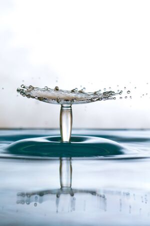 colliding: Water drop falling and colliding with another one Stock Photo