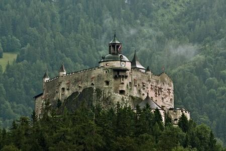 Hohenwerfen castle in Austria on Alps backgrond