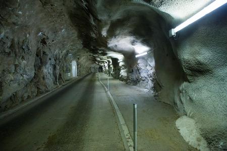 Underground illuminated cave tunnel