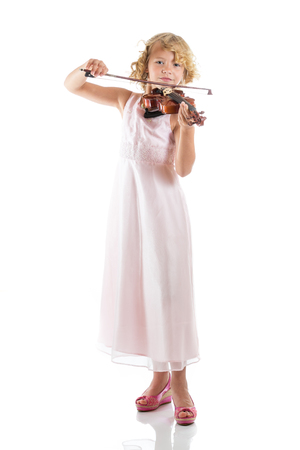 Girl playing a violin on isolated white background