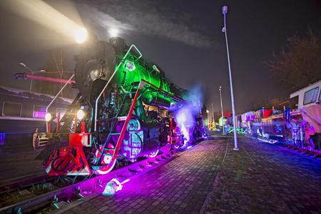 loco: Soviet locomotive train colored at night Editorial