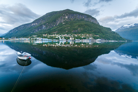 Reflection of lake, mountain and the boat in Norway