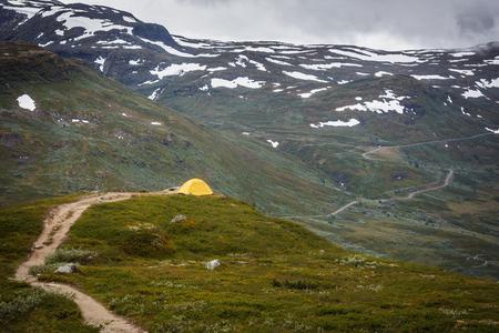 Yellow tent in Norway mountains Standard-Bild