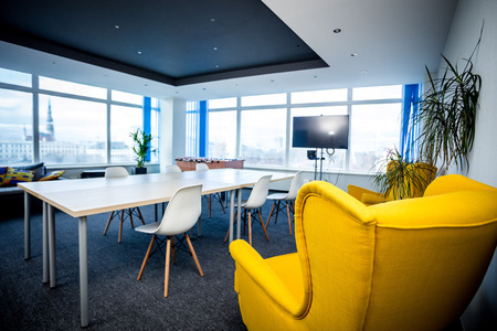 Office meeting room interior in Riga with yellow chair Standard-Bild