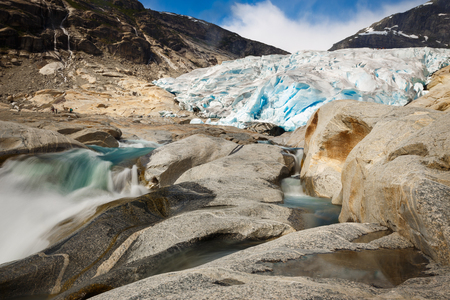 Nigardsbreen Glacier in Norway with river and ice