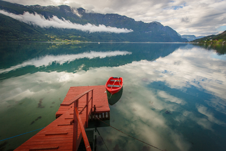 Red boat with reflaction in Norway