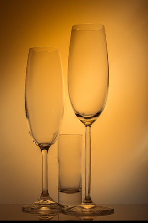 Champagne glass on yellow background in studio