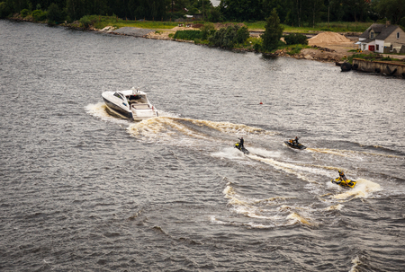 Motor bikes jumping on the waves in Riga