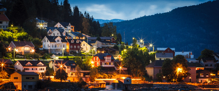 Norway city at night with mountains