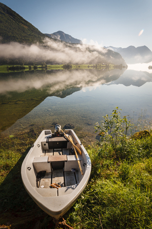 Lake in Norway with for and trees Imagens