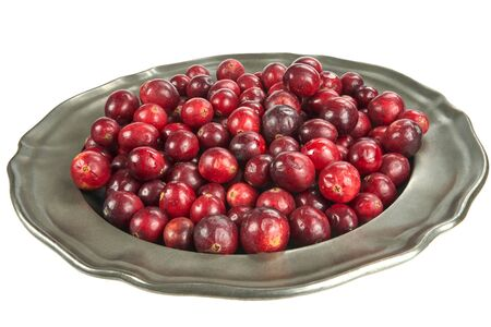 Fresh cranberry on an old metal plate, on white background Stock Photo