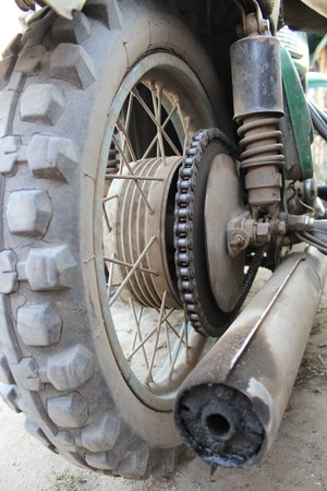 greasing: Wheel of the old motorcycle