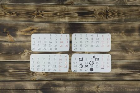 Sheets of a calendar month on a wooden natural background