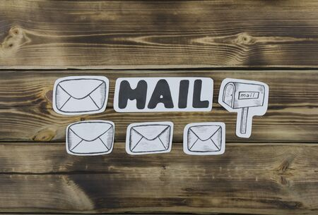 Paper sketched sketches with mail-themed letters on wooden 스톡 콘텐츠