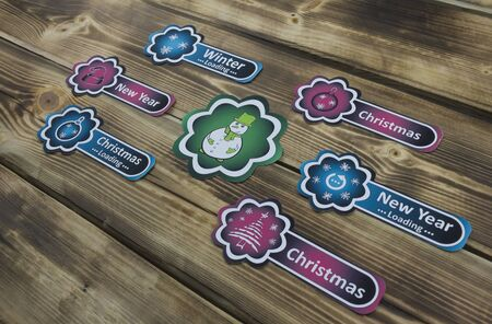 Color sticker with Christmas illustration on wooden background 스톡 콘텐츠