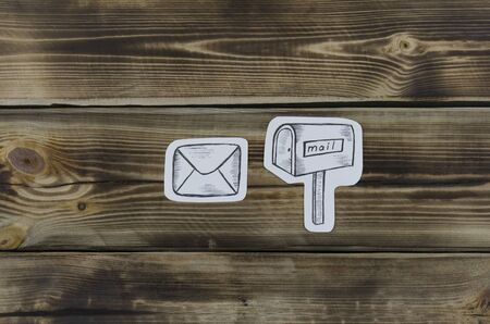 Paper sketched sketches with mail-themed letters on wooden 写真素材