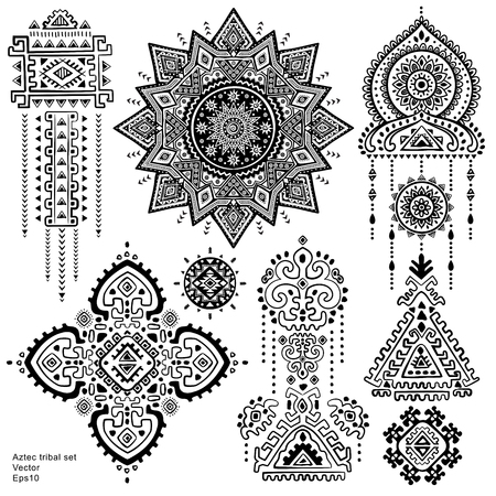 Set of isolated ornamental tribal elements and symbols Vectores