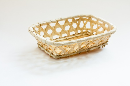 An Empty Woven Straw Basket photo