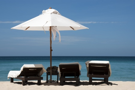 3 chairs   an umbrella on the beach in Phuket, Thailand  Image is not sharpened for future editing   Stock Photo - 13117940