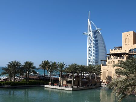 Dubai, UAE - June 18, 2007: View of Burj Al Arab and Mina a'Salam Hotels from Souk Madinat Jumeirah.