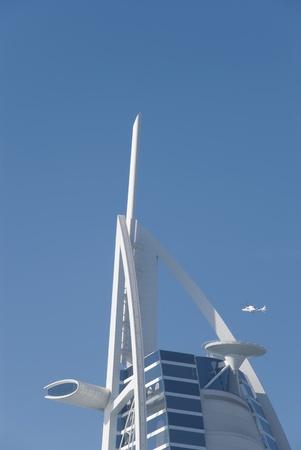 Dubai, UAE - June 18, 2007: Helicopter landing to helipad of Burj Al Arab Hotel
