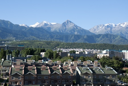 alma: Almayt skyline with residential buildings and view of Tien Shan mountain