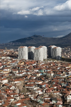 View of rising apartments among old houses at suburbs in Ankara, Turkey  Stock Photo