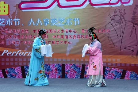 Shanghai, China - October 23, 2009: Theatrical performance of an actor and actress on street. Editorial