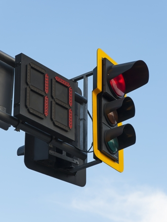 Traffic light with red light, that will be lit for 17 minutes more.