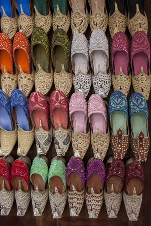 souk: Colorful arabic shoes alignment for sale on street  Stock Photo