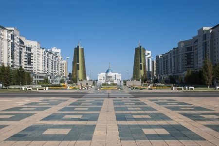 View of Nurzhol Boulevard (Green Water Boulevard) with the parliament and treasury buildings accross, in Astana, Kazakhstan. Stock Photo