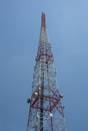 Telecommunication tower with phone base stations and dishes. Stock Photo