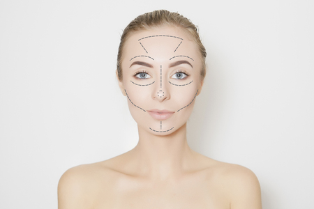 surgical removal: Closeup of female adult with  marks on skin for cosmetic medical procedures Stock Photo