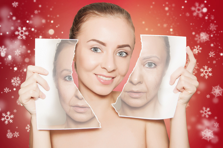 skin revitalising concept: woman with pure skin holding paper with empty space close to her face