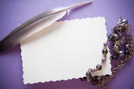 vintage background with black pearls and colorful papers